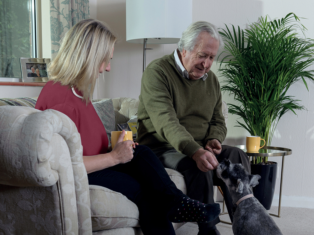 Carer, client and dog