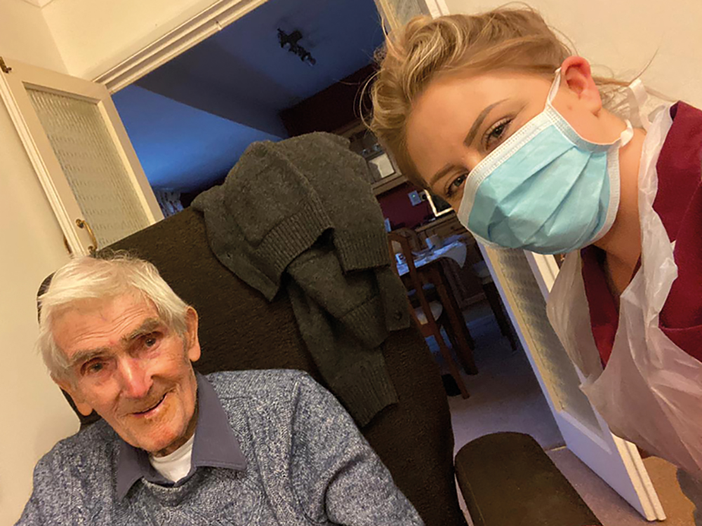 Carer with PPE and client